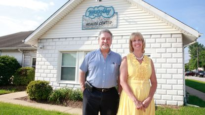 Magothy Health Association president John Clark with Magothy Health Center's program supervisor Amy Kane on June 19 at the health center on Mountain Road. The center helps provide free well-woman health screenings for low income Anne Arundel County residents.