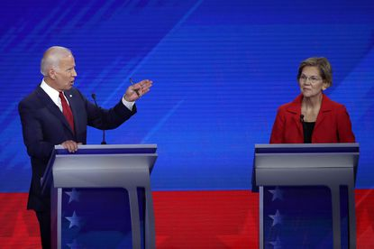Democratic presidential candidates former Vice President Joe Biden and Sen. Elizabeth Warren (D-MA) interact on stage during the Democratic Presidential Debate at Texas Southern University's Health and PE Center on September 12, 2019 in Houston, Texas.