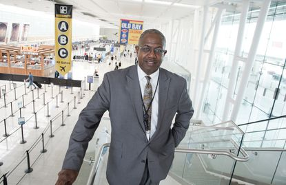Ricky Smith Sr., the new CEO at BWI Thurgood Marshall Airport, stands above the terminal that is the home to Southwest Airlines.