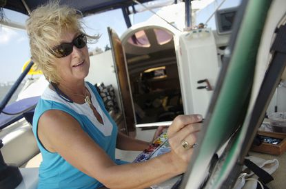 Christine O'Neill paints aboard her catamaran sailboat on the Chesapeake Bay. Christine O'Neill, a local watercolor artist, and her husband David O'Neill, an illustrator, live aboard their 45-foot catamaran. The O'Neills currently have an exhibition on display at the Annapolis Maritime Museum of art they made cruising the East Coast and the Bahamas.