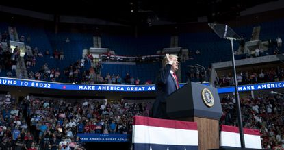 President Donald Trump addresses a campaign rally in Tulsa, Okla., on Saturday, June, 20, 2020. The hall, which seats 19,000, was less than one-third full for his first rally in three months, according to Tulsa Fire Department figures.