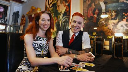 Magician Spencer Horsman, right, proposed to Caroline Gayle, his onstage assistant, during one of his recent show at Illusions Bar & Theater on Charles Street in Federal Hill.