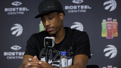 Raptors' DeMar DeRozan speaks during an end-of-season news conference at the BioSteel Centre in Toronto on May 8. Earlier this season, NBA stars Kevin Love of the Cleveland Cavaliers and DeRozan revealed issues they've struggle with on and off the court.