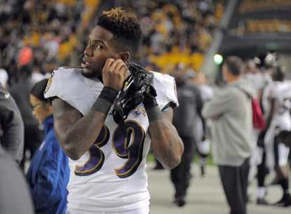 Ravens cornerback Will Davis adjusts his jewelry on the sideline in the first quarter of the Ravens game against the Steelers at Heinz Field in Pittsburgh.