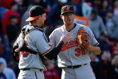 Orioles pitcherKevin Gausman celebrates with Caleb Joseph after the game against the Boston Red Sox at Fenway Park on April 19, 2015 in Boston.