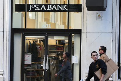People walk past a Jos. A. Bank retail store on December 5, 2013 in San Francisco, California.