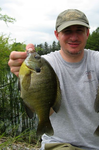 Jim Gronaw's son Matt Gronaw shows a typical B&C bluegill with this 10¼ incher taken from a local pond.