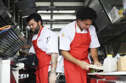 Justin Devillier (left) and Michael Sichel get to work on their food truck.