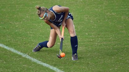 Marriotts Ridge's Emma Gladstein gets under the ball as she sends a pass in the air during a field hockey game at River Hill High School on Thursday, Oct. 4.