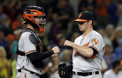 Orioles catcher Caleb Joseph, left, and closerZach Britton react after the team beat the Seattle Mariners, 3-2, Monday, Aug. 10, 2015, in Seattle.