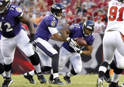 Joe Flacco hands off to Ray Rice in the first quarter against the Buccaneers.