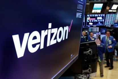 This April 23, 2018, file photo shows the logo for Verizon above a trading post on the floor of the New York Stock Exchange. (AP Photo/Richard Drew, File)
