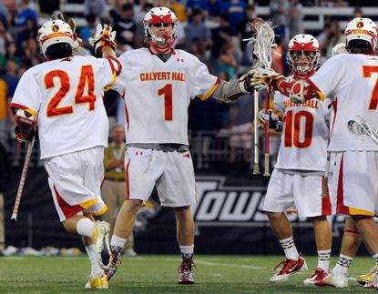 Calvert Hall's Stephen Kelly, left, Carter Brown, second from left, Jordan Germershausen, third from left, and Patrick Kelly, right, celebrate Brown's goal that made is 1-0 in the first half of the MIAA A Conference lacrosse championship.