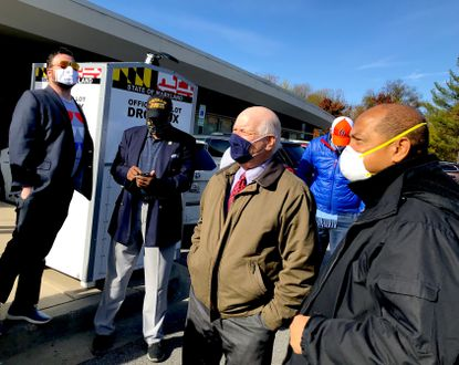 Sen. Ben Cardin, center, and Baltimore County Councilman Julian Jones, right, greet voters at the Randallstown Community Center on Election Day 2020.