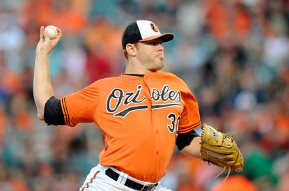 Orioles starterChris Tillman pitches in the first inning against the Minnesota Twins at Camden Yards on Aug. 22, 2015 in Baltimore.