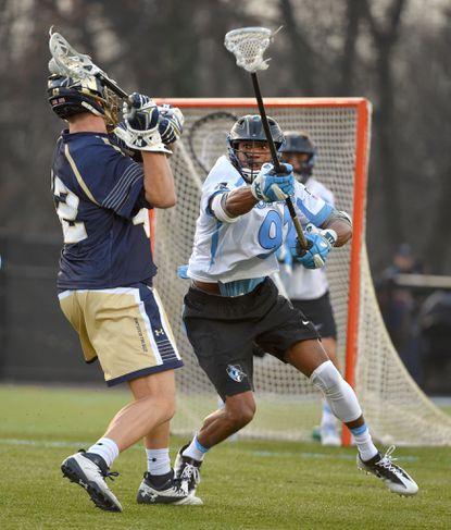 Hopkins' Nick Fields defends Navy's Jack Ray in the first half.