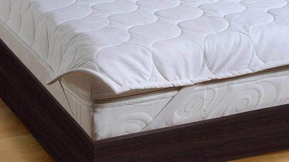 Use a mattress protector in addition to a standard bottom sheet — not instead of one.