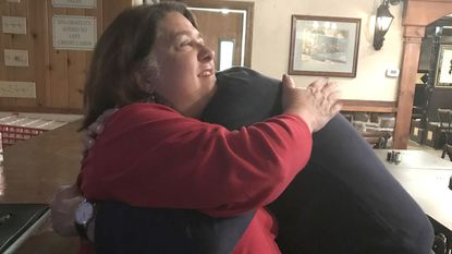 Diane Adkins-Tobin receives a hug from Dave Ryden, a colleague in the Harford County State's Attorney's Office, after she received the most votes in Tuesday's election to become a Harford County Circuit Court judge.