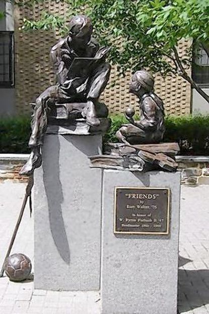 """Part of a longtime bronze statue at Friends School has been stolen, Nothern District police said. The statue sits on the upper school plaza on the campus at 5114 North Charles St. Made by the noted local sculptor Bart Walter, whose studio is located in Westminster, Md., the statue is called """"Friends."""" It shows a boy reading to a girl — both sitting on stacks of books — and includes a lacrosse stick among other sports items. Someone stole the lacrosse stick between 10:30 p.m. July 14 and 6:30 a.m. July 15, police said. The statue was dedicated in 1998 to retiring 38-year headmaster Byron Forbush, Friends School spokeswoman Heidi Blalock said."""