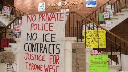 Signs cover the walls inside of Garland Hall during the sit-in at Johns Hopkins University. A group of students sat in the university's administration building, marking the second week they'd occupied Garland Hall as part of their protest against private police.