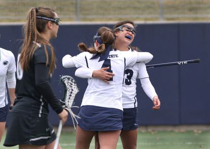 Penn State's Steph Lazo (23) celebrates her second goal with Madison Cyr (4) against Loyola Maryland on March 5, 2016. Lazo's four straight goals led No. 8 Penn State's 11-8 comeback win over Loyola.