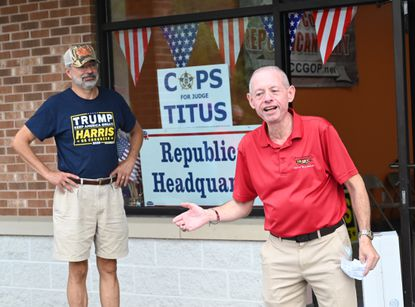 U.S. Rep. Andy Harris, left, listens as Del. Haven Shoemaker speaks to the group gathered for the opening of the Carroll County Republican Central Committee headquarters, located in Finksburg, on Saturday, Sept. 12.