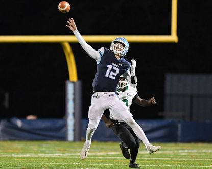 South River quarterback David Foust (12), seen during a 4A East Region second round playoff game against the Arundel on Nov. 15, announced he will walk on at Maryland this fall.