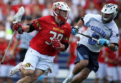 Maryland midfielder Henry West (38) in action against North Carolina midfielder Brett Bedard (3) during the NCAA lacrosse quarterfinals.