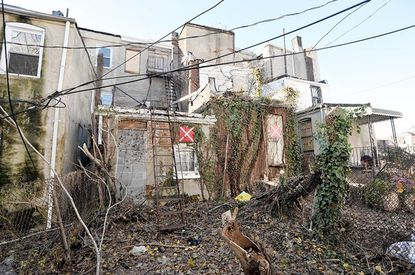 """The rear of a vacant house at 825 N. Caroline, marked with """"X"""" on the left, where a 13-year-old was raped in October."""