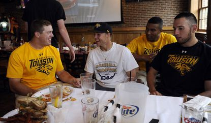 From left, Towson baseball players Andrew Parker, Brandon Gonnella, Mike Bronakoski and Mike Volpe celebrate the Tigers' NCAA tournament selection at the Charles Village Pub in Towson.
