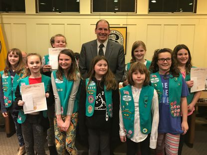 Members of Girl Scout Junior Troop 1020 stand with Sykesville Mayor Ian Shaw at the Jan. 13 Town Council meeting.