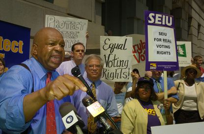 Less than two weeks after the death of U.S. Rep. Elijah Cummings, the Baltimore City Council is set to consider legislation naming Baltimore's Courthouse East in his honor. Cummings is shown in this 2005 file photo outside the neighboring Clarence M. Mitchell Jr. Courthouse. The two buildings house Baltimore Circuit Court.