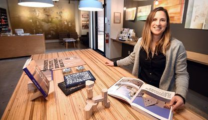 Architect Megan Elcrat is pictured in Co_Lab architectural library at 2209 Maryland Avenue that she and her husband, architect Phillip Jones opened.