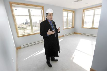 Govans Ecumenical Development Corporation Executive Director Mitchell Posner stands in a bedroom at The Green House Residences at Stadium Place in January, when the long-term nursing facility was under construction at the former site of Memorial Stadium.