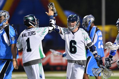 Ben Rubeor of the Chesapeake Bayhawks celebrates with Joe Walters after Rubeor scored the winning goal in overtime against the Ohio Machine on Saturday night at Selby Stadium in Delaware, Ohio. Chesapeake won, 12-11.
