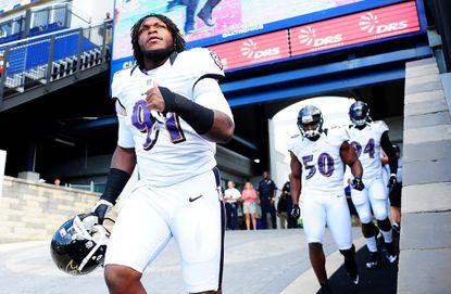 Ravens rookie linebacker Courtney Upshaw runs onto the field during training camp last week.
