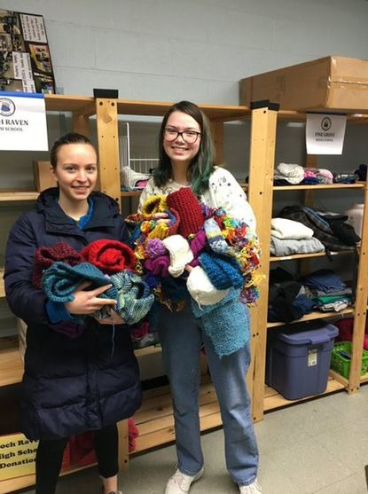 Towson High's Sophia Grose, left, and Sophie Harrell founded the Knit for Needy Club at the school.