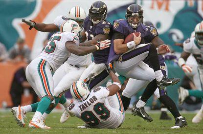 Miami defensive end Jason Taylor sacks Ravens quarerback Kyle Boller during a game at Dolphins Stadium on Dec. 16, 2007.