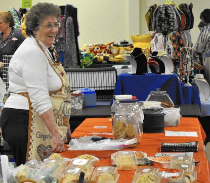 Pat Desautels sells baked goods and church cookbooks at last year's Pleasant Valley Fall _Festival.___- Original Credit: Submitted photo