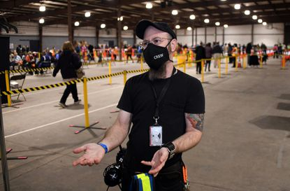 Terry Sapp, Public Health Emergency Coordinator for Baltimore County, designed the vaccine delivery site at the Timonium Fairgrounds. He is a logistics expert, having worked with the rock band Twisted Sister for several years. February 24, 2021