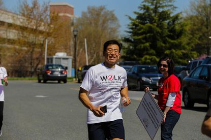 Dr. Fred Chan, 2017 event chairman, participates in the 1st annual Walk a Mile in Her Shoes one-mile awareness walk at the Greater Baltimore Medical Center campus in 2016. This year's walk will be April 22.