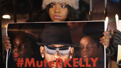 """Demonstrators gather near the studio of singer R. Kelly to call for a boycott of his music after allegations of sexual abuse against young girls were raised on the highly-rated Lifetime documentary series """"Surviving R. Kelly"""" on January 09, 2019, in Chicago."""