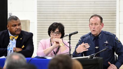 Harford County Sheriff Jeffrey Gahler, right, answers a question as Harford School Superintendent Barbara Canavan, center, and Chief of Safety and Security for the school system Donoven Brooks, left, listen during a school security town hall meeting.