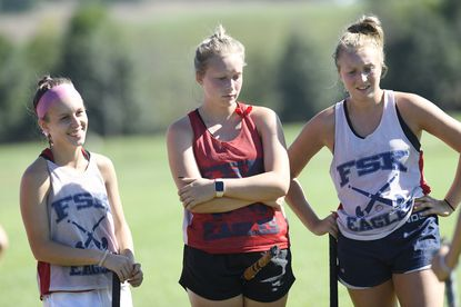 Siblings Katelyn, Brooke and Hannah Boyer listen to FSK head coach Lori Knights during a field hockey practice in Uniontown Friday, Sept. 24, 2021.
