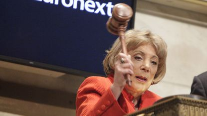 FILE - In this April 1, 2009, file photo, Evelyn Y. Davis uses a gavel to ring the closing bell at the New York Stock Exchange in New York. Davis, who owned stock in more than 80 public companies and liked to make a show of her presence at shareholder meetings, died Sunday, Nov. 4, 2018. She was 89. (AP Photo/Seth Wenig, File)