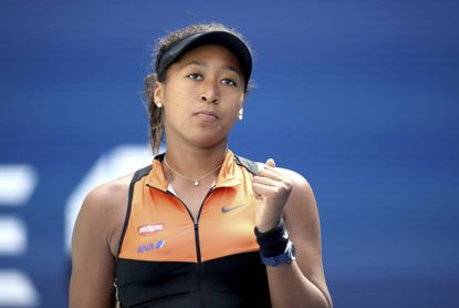 Naomi Osaka, of Japan, reacts after defeating Anna Blinkova, of Russia, during the first round of the US Open tennis tournament Tuesday, Aug. 27, 2019, in New York. (AP Photo/Michael Owens)