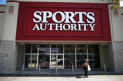 A Sports Authority store is shown in Miami. The chain of stores owned by private equity firm Leonard Green & Partners will seek to sell or close about 140 stores.