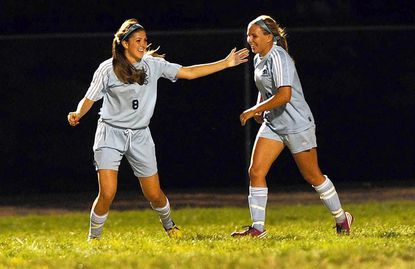 River Hill's Michaela Hennessy, left, celebrates her goal with teammate Alex Hamer during a game Friday at Glenelg. River Hill won to remain undefeated.