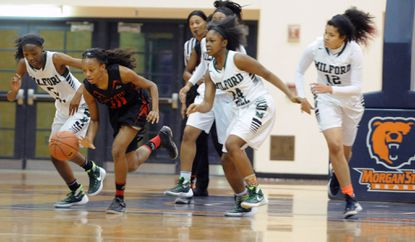Second from left, Kyaja WilliamsofWestern (10) makes a break with the ball as she is followed by Milford Mill players in the second quarter on Jan. 16, 2016, at the 20th annual Baltimore City Public Schools Basketball Academy at Morgan State University.