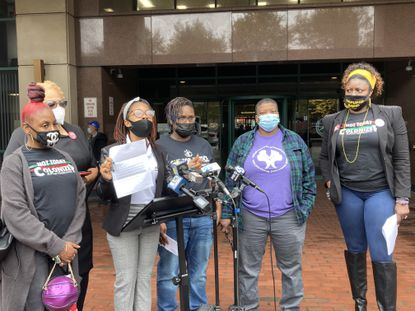 Latasha Fason, center, and voting rights advocates speak outside Baltimore elections offices. Fason was sent a letter saying she could not register to vote because of a felony conviction, despite a 2016 state law that ensures Marylanders convicted of felonies can register to vote as soon as they are released from prison